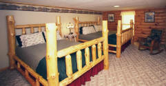 This large room has 1 King and 1 Queen hand-made Wisconsin native white pine log beds.