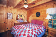 This room has beautiful solid oak furniture with a queen-size bed